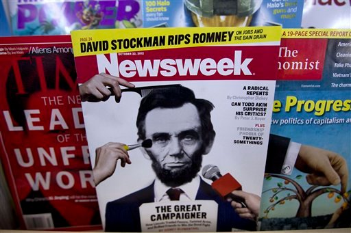 A copy of Newsweek is seen at Joe's Smoke, Thursday, Oct. 18, 2012, in Portland, Maine. (AP Photo/Robert F. Bukaty)