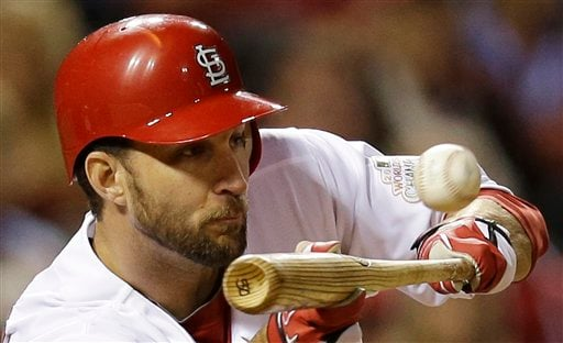 © St. Louis Cardinals' Adam Wainwright bunts during the sixth inning of Game 4 of baseball's National League championship series against the San Francisco Giants Thursday, Oct. 18, 2012, in St. Louis.