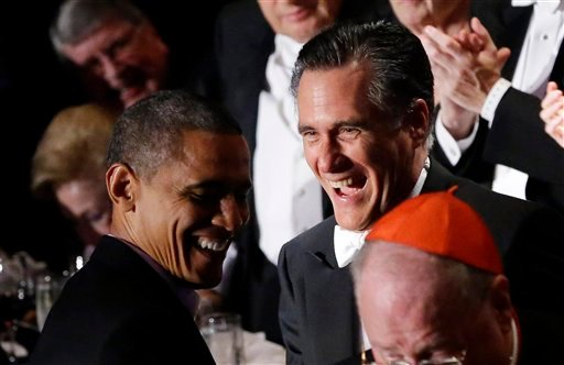 © Republican presidential candidate and former Massachusetts Gov. Mitt Romney and President Barack Obama laugh as Romney gets up to address the 67th annual Alfred E. Smith Memorial Foundation Dinner.