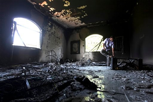 FILE - In this Sept. 13, 2012 file photo, a Libyan man investigates the inside of the U.S. Consulate, after an attack that killed four Americans, including Ambassador Chris Stevens on the night of Tuesday, Sept. 11, 2012, in Benghazi, Libya.