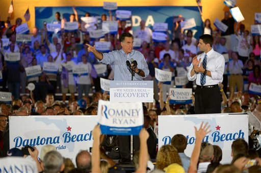 © Republican presidential candidate, former Massachusetts Gov. Mitt Romney, left, addresses supporters as his vice presidential running mate Rep. Paul Ryan, R-Wis., listens at the Daytona Beach Historic Bandshell during the Romney Ryan Victory Rally.