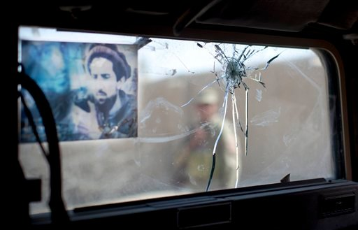 © An Afghan National policeman is seen through a windscreen of an armored vehicle shattered by a single bullet in Lashkar Gah, Helmand Province, Afghanistan, Thursday, Oct 18, 2012.