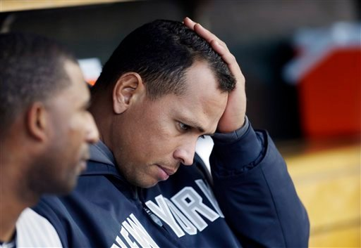 © New York Yankees' Alex Rodriguez watches from the bench during Game 4 of the American League championship series against the Detroit Tigers Thursday, Oct. 18, 2012, in Detroit.