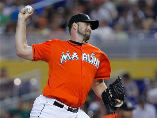 © In this July 29, 2012, photo, Miami Marlins' Heath Bell pitches during a baseball game against the San Diego Padres in Miami. The Marlins traded Bell to the Arizona Diamondbacks on Saturday, Oct. 20, 2012.