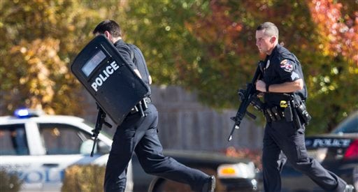 © Police and swat team members respond to a call of a shooting at the Azana Spa in Brookfield, Wis. Sunday,Oct. 21, 2012. Multiple people were wounded when someone opened fire at the spa near the Brookfield Square Mall.
