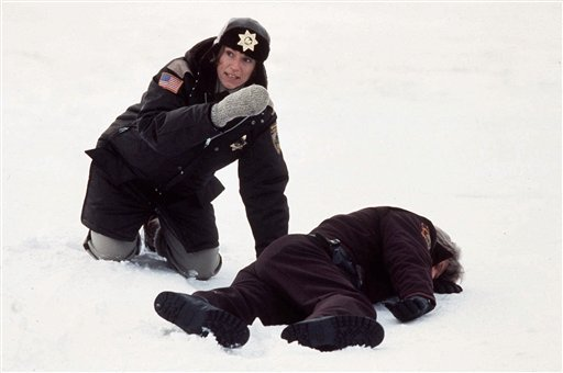 """©  In this 1996 file publicity photo originally released by Gramercy Pictures, actress Frances McDormand, left, is shown in this scene from the movie """"Fargo."""""""