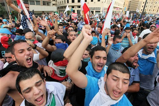 © Lebanese protesters chant slogans against the Lebanese government after the funeral of Brig. Gen. Wissam al-Hassan, who was assassinated on Friday by a car bomb in Beirut, Lebanon, Sunday Oct. 21, 2012.