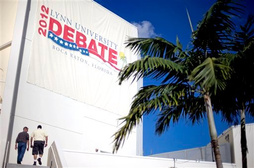© Workers enter the debate hall ahead of Monday's presidential debate between Republican presidential candidate and former Massachusetts Gov. Mitt Romney and President Barack Obama, Sunday, Oct. 21, 2012, at Lynn University in Boca Raton, Fla.