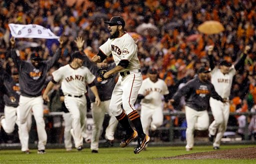 © San Francisco Giants relief pitcher Sergio Romo reacts after the final out in Game 7 of baseball's National League championship series against the St. Louis Cardinals Monday, Oct. 22, 2012, in San Francisco. The Giants won 9-0 to win the series.