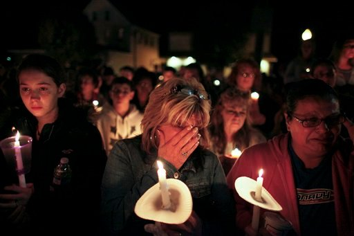 © Members of the community participate in a candlelight vigil for Autumn Pasquale, Monday Oct. 22, 2012, in Clayton, N.J. About 200 law enforcement officials and hundreds more volunteers searched Monday for Autumn.