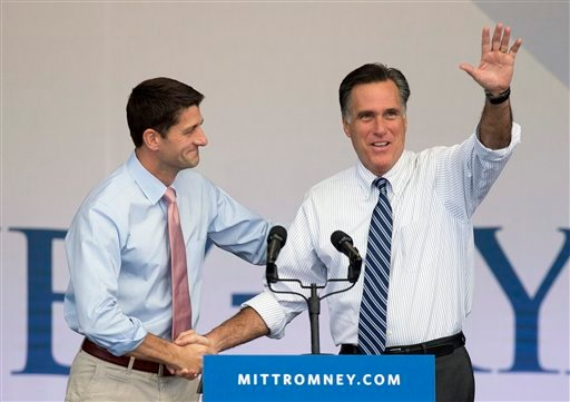 Republican presidential candidate former Massachusetts Gov. Mitt Romney, right, is greeted by running mate Rep. Paul Ryan, R-Wis., at the start of a rally, Tuesday, Oct. 23, 2012, in Henderson, Nev. (AP Photo/Julie Jacobson)