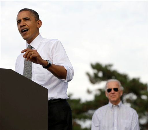 Vice President Joe Biden listens at right as President Barack Obama speaks during a campaign event at Triangle Park in Dayton, Ohio, Tuesday, Oct. 23, 2012. (AP Photo)