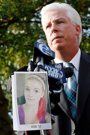 A photograph of Autumn Pasquale is seen as Gloucester County Prosecutor Sean Dalton addresses a gathering outside town hall Tuesday, Oct. 23, 2012, in Clayton, N.J. (AP Photo/Mel Evans)