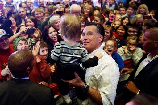 Republican presidential candidate, former Massachusetts Gov. Mitt Romney holds a child as he greets supporters at an election campaign rally at the Reno Event Center in Reno, Nev., Wednesday, Oct. 24, 2012. (AP Photo/Charles Dharapak)