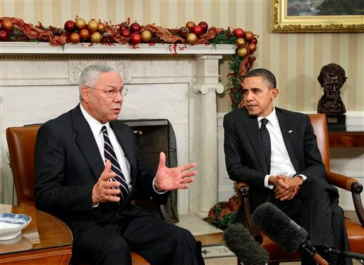 In this Dec. 1, 2010 file photo, former Secretary of State Colin Powell meets with President Barack Obama, in the Oval Office at the White in Washington. (AP Photo/J. Scott Applewhite, File)