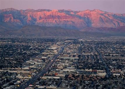 In this Feb. 9, 2005, file photo, shows the suburbs of Las Vegas from atop the Stratosphere tower looking west down Sahara Ave. towards the Spring Mountains.  (AP Photo/Joe Cavaretta, File)