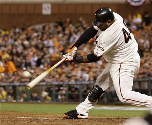 San Francisco Giants' Pablo Sandoval hits a home run during the fifth inning of Game 1 of baseball's World Series against the Detroit Tigers Wednesday, Oct. 24, 2012, in San Francisco. (AP Photo/Marcio Jose Sanchez)