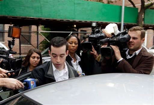 A man claiming to be the brother of New York City Police Officer Gilberto Valle is questioned by the media Thursday, Oct. 25, 2012, in the Queens borough of New York. (AP Photo/Frank Franklin II)