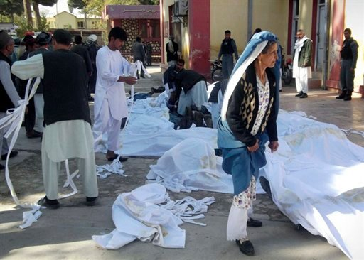 © Bodies of suicide attack victims are covered in white cloth in the courtyard of a hospital in Maymana, Faryab province, northwest of Kabul, Afghanistan, Friday, Oct. 26, 2012.