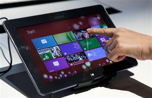 © A person tries a Samsung tablet computer running Windows 8 at the launch of Microsoft Windows 8, in New York, Thursday, Oct. 25, 2012. Windows 8 is the most dramatic overhaul of the personal computer market's dominant operating system in 17 years.
