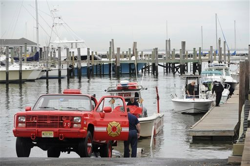 © As Hurricane Sandy moves up the East Coast, members of the Highlands Fire Department remove the rescue boat from the Atlantic Highlands Marina, Friday Oct. 26, 2012 in Atlantic Highlands, N.J. (AP Photo/Joe Epstein)