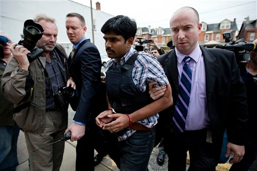 © Raghunandan Yandamuri is escorted to a Montgomery County district court for an arraignment Friday, Oct. 26, 2012, in Bridgeport, Pa. Investigators said Yandamuri killed 10-month-old Saanvi Venna and her grandmother in a botched ransom kidnapping.