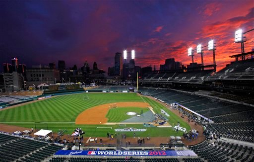 © Clouds are illuminated at sunset over Comerica Park in Detroit, Friday, Oct. 26, 2012. The Tigers host the San Francisco Giants in Game 3 of baseball's World Series n Saturday. The Giants lead the best-of-seven series 2-0.
