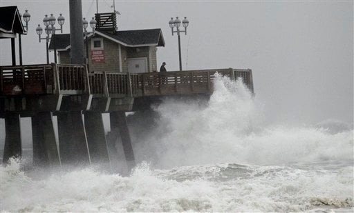 © Large waves generated by Hurricane Sandy crash into Jeanette's Pier in Nags Head, N.C., Saturday, Oct. 27, 2012 as the storm moves up the east coast.