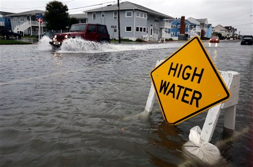 © A car goes through the high water as Hurricane Sandy bears down on the East Coast, Sunday, Oct. 28, 2012, in Ocean City, Md.