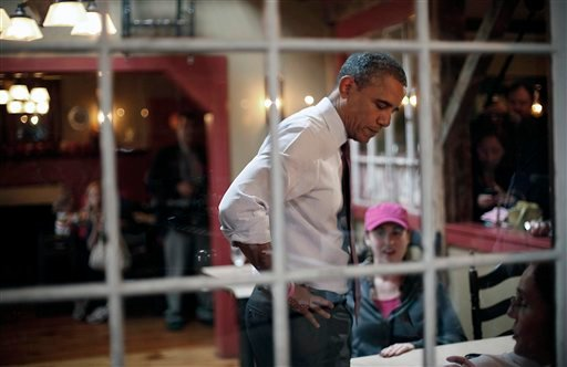  President Barack Obama greets local patrons during an unscheduled visit to the Common Man Merrimack restaurant, Saturday, Oct. 27, 2012 in Merrimack, NH. (AP Photo/Pablo Martinez Monsivais)