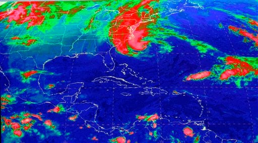 © This satellite image from the National Hurricane Center in Miami shows Sandy, at 10:03 a.m., Sunday, Oct. 28, 2012. Hurricane Sandy was headed north from the Caribbean, where it left nearly five dozen dead, to meet a winter storm and a cold front.