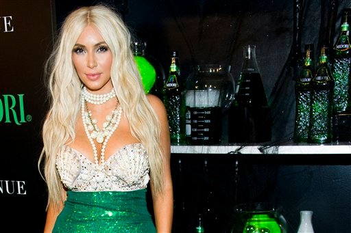 © Kim Kardashian hosts the 2nd Annual Midori Green Halloween Party on Saturday, Oct. 27, 2012 in New York. (Photo by Charles Sykes/Invision/AP)