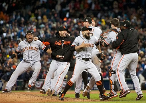 © The San Francisco Giants celebrate defeating the Detroit Tigers in Game 4 of baseball's World Series on Sunday, Oct. 28, 2012, in Detroit. The Giants won the World Series 4-0.