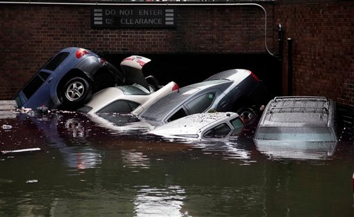 Cars are submerged at the entrance to a parking garage in New York's Financial District in the aftermath of superstorm Sandy, Tuesday, Oct. 30, 2012. (AP Photo/Richard Drew)
