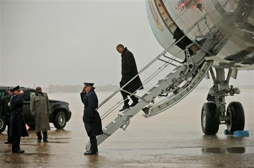 President Barack Obama steps off Air Force One upon his arrival at Andrews Air Force Base, Md., Monday, Oct. 29, 2012. (AP Photo/Pablo Martinez Monsivais)