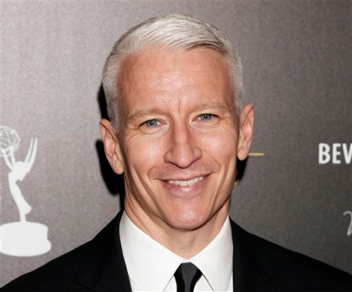 FILE - This June 23, 2012 file photo shows CNN's Anderson Cooper as he arrives at the 39th Annual Daytime Emmy Awards at the Beverly Hilton Hotel in Beverly Hills, Calif. (Photo by Todd Williamson/Invision/AP, file)