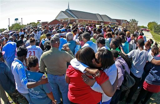 © Hundreds of distraught church members gather at the Greater Sweethome Missionary Baptist Church, Monday, Oct. 29, 2012, in Forest Hill, Texas, after the church's founding pastor was killed Monday by an attacker who rammed a car into a church wall.