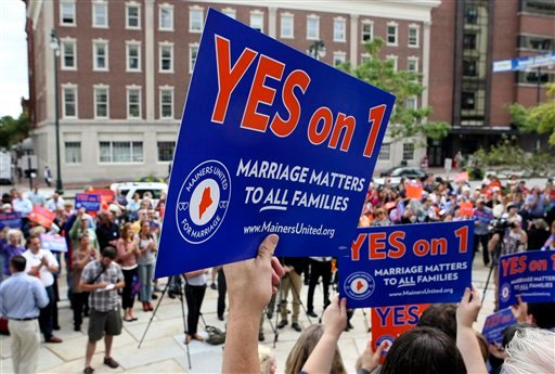 © In this Sept. 10, 2012, file photo, gay marriage supporters gather at a rally outside of City Hall in Portland, Maine, in support of an upcoming ballot question that seeks to legalize same-sex marriage.