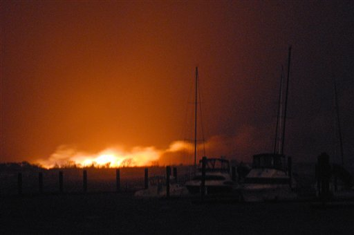 © A fire burns at least two dozen homes in a flooded neighborhood in the New York City borough of Queens on Tuesday, Oct. 30, 2012. A fire department spokesman says more than 190 firefighters are at the blaze in the Breezy Point section.