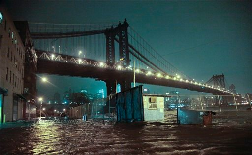 © Streets are flooded under the Manhattan Bridge in the Dumbo section of Brooklyn, N.Y., Monday, Oct. 29, 2012. Sandy continued on its path Monday, as the storm forced the shutdown of mass transit, schools and financial markets.