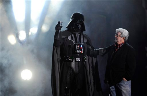 "FILE - In this Oct. 15, 2011 file photo, ""Darth Vader"" accepts the Ultimate Villain award from ""Star Wars"" creator George Lucas during the 2011 Scream Awards, in Los Angeles. AP Photo/Chris Pizzello, File)"