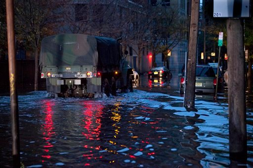 A National Guard truck drives through high water on Newark Street in Hoboken, N.J. Wednesday, Oct. 31, 2012 in the wake of superstorm Sandy. (AP Photo/Craig Ruttle)