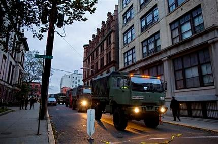 Members of the National Guard stand ready with large trucks used to pluck people from high water in Hoboken, N.J. Wednesday, Oct. 31, 2012 in the wake of superstorm Sandy. (AP Photo/Craig Ruttle)