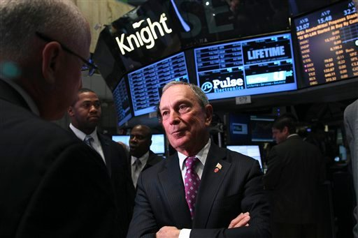 Mayor Michael Bloomberg talks to traders before ringing the opening bell at the New York Stock Exchange in New York, Wednesday, Oct. 31, 2012. (AP Photo/Seth Wenig)