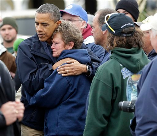 President Barack Obama, left, embraces Donna Vanzant, right, during a tour of a neighborhood effected by superstorm Sandy, Wednesday, Oct. 31, 2012 in Brigantine, N.J. (AP Photo/Pablo Martinez Monsivais)