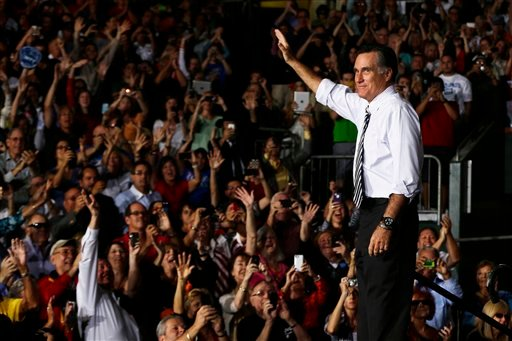 Republican presidential candidate, former Massachusetts Gov. Mitt Romney waves during a campaign stop at the Bank United Center, at The University of Miami, in Coral Gables, Florida, Wednesday, Oct. 31, 2012. (AP Photo/Charles Dharapak)