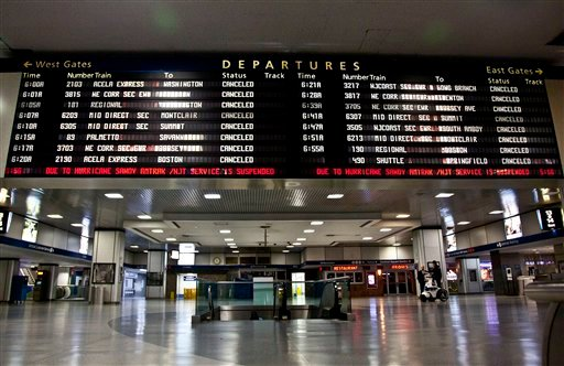A timetable board displays continued cancellations at Penn Station as MTA resumed limited service on Thursday, Nov. 1, 2012, in New York. (AP Photo/CX Matiash)