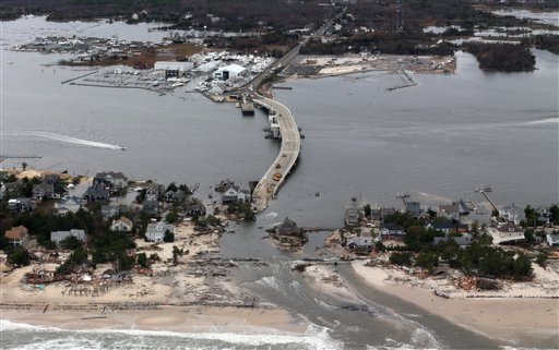 This aerial photo made from a helicopter shows storm damage from Sandy over the Atlantic Coast in Mantoloking, N.J., Wednesday, Oct. 31, 2012. (AP Photo/Doug Mills, Pool)