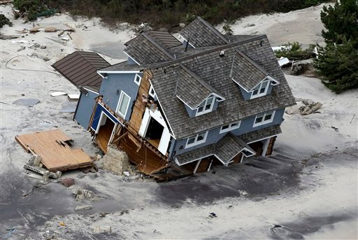 This aerial photo shows a collapsed house along the central Jersey Shore coast on Wednesday, Oct. 31, 2012, over New Jersey. (AP Photo/Mike Groll)