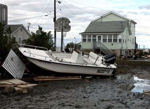A boat tossed into a neighborhood in the wake of superstorm Sandy on Wednesday, Oct. 31, 2012, in Cedar Bonnet Island, N.J. (AP Photo/Robert Ray)